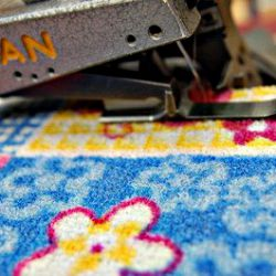 Hemming rugs and carpets